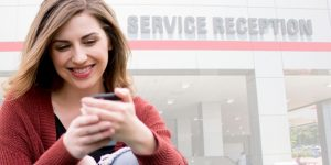 Happy auto service customer using myKaarma